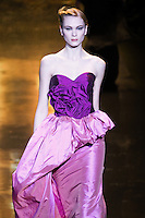 Irina Kulikova walks runway in an outfit from the Badgley Mischka Fall 2011 fashion show, during Mercedes-Benz Fashion Week Fall 2011.