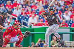 22 September 2013: Miami Marlins infielder Donovan Solano at bat as his brother Jhonatan Solano catches during game action against the Washington Nationals at Nationals Park in Washington, DC. The Marlins defeated the Nationals 4-2 in the first game of their day/night double-header. Mandatory Credit: Ed Wolfstein Photo *** RAW (NEF) Image File Available ***