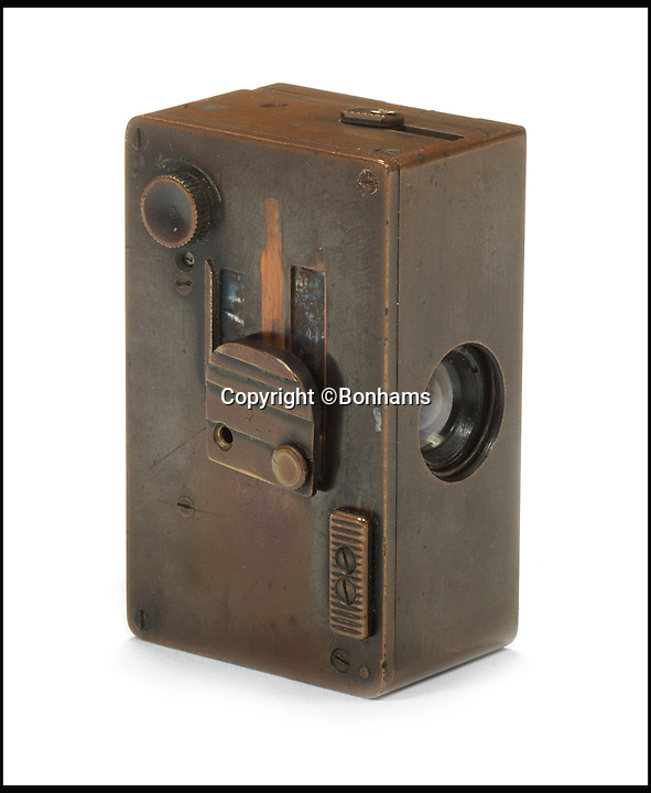 BNPS.co.uk (01202 558833)Pic: Bonhams/BNPS<br /> <br /> Mast concealable camera, 1950. Estimate &pound;5,100 - &pound;8,500.<br /> <br /> An incredible archive of rare vintage spy cameras that would rival James Bond's own collection has emerged for sale for a staggering &pound;400,000.<br /> <br /> The Heath Robinson-style cameras date from the 1880s and come in numerous wacky guises including a book, a wristwatch, a packet of cigarettes, binoculars and even a handgun.<br /> <br /> Many of the ingenious devices were commercial failures and so very few were made, making surviving examples worth tens of thousands of pounds now.<br /> <br /> The collection will be sold at London auctioneers Bonhams on December 3.