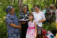 Annual gathering of the Seventh Day Adventists in the village of Salcioara on the Saturday following the harvest of the linden honey. The Adventists make up the majority of the inhabitants of Salcioara on the Black Sea and half of the men are beekeepers by trade.
