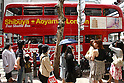 May 5, 2010 - Tokyo, Japan - Walkers look at a Routemaster bus in Tokyo, Japan on May 5, 2010. The double-decker legend is used during the public holidays called 'Golden Week' as free shuttle between Shibuya and Aoyama for the promotion of the British luxury brand group Vulcanize London.