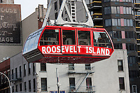 The newly renovated Roosevelt Island Tram approaches the Manhattan station.