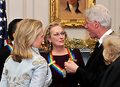 Meryl Streep, one of the five recipients of the 2011 Kennedy Center Honors, center, and United States Secretary of State Hillary Rodham Clinton, right, listen to former U.S. President Bill Clinton, right, following a dinner hosted by Secretary Clinton at the U.S. Department of State in Washington, D.C. on Saturday, December 3, 2011. The 2011 honorees are actress Meryl Streep, singer Neil Diamond, actress Barbara Cook, musician Yo-Yo Ma, and musician Sonny Rollins..Credit: Ron Sachs / CNP