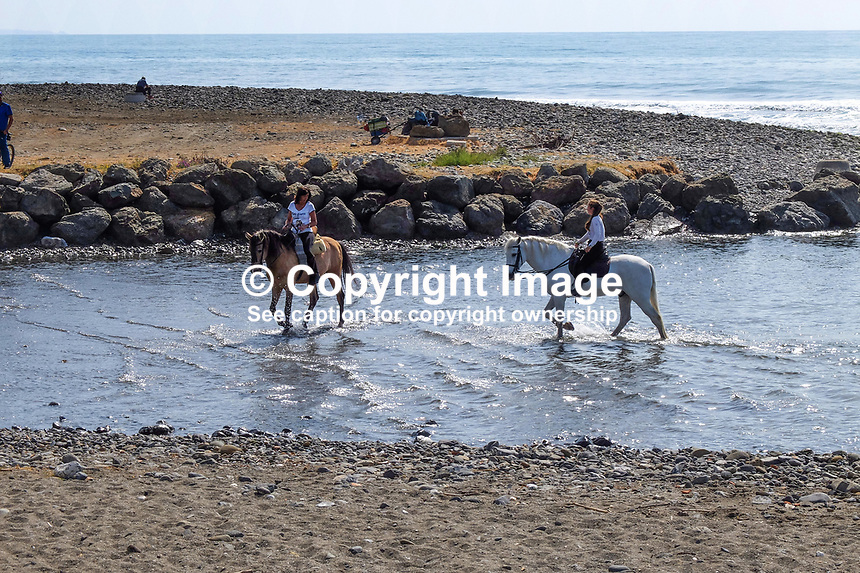 Horses cool the heels in the Mediterranean near Puerto Banus, Spain, when out for a Sunday canter along the Costa del Sol. 23rd April 2017, 201704233482<br /><br />Copyright Image from Victor Patterson, 54 Dorchester Park, <br />Belfast, UK, BT9 6RJ<br /><br />t1: +44 28 9066 1296 (from Rep of Ireland 048 9066 1296)<br />t2: +44 28 9002 2446 (from Rep of Ireland 048 9002 2446)<br />m: +44 7802 353836<br /><br />e1: victorpatterson@me.com<br />e2: victorpatterson@gmail.com<br /><br />www.victorpatterson.com<br /><br />Please see my Terms and Conditions of Use at www.victorpatterson.com. It is IMPORTANT that you familiarise yourself with them.<br /><br />Images used on the Internet must be visibly watermarked i.e. &copy; Victor Patterson within the body of the image and copyright metadata must not be deleted. Images used on the Internet have a size restriction of 4kbs and will be chargeable at current NUJ rates unless agreed otherwise.<br /><br />This image is only available for the use of the download recipient i.e. television station, newspaper, magazine, book publisher, etc, and must not be passed on to any third party. It is also downloaded on condition that each and every usage is notified within 7 days to victorpatterson@me.com<br /><br />The right of Victor Patterson to be identified as the author is asserted in accordance with The Copyright Designs And Patents Act (1988).