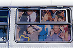 City bus ad with people stuffed into bus