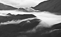 "Clouds settle around cinder cones in Haleakala ""Crater"" in Haleakala National Park, Maui."