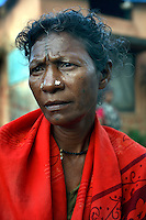 Mutti Muchaki sits in her village Nendra. In 2005 the Salwa Judam militia and police forced her and her family to the nearby Salwa Judam camp of Errabore seven kilometres away. She was never to see her husband or two sons again, later she heard that the Salwa Judam had killed them with knifes throwing their bodies into a drain.