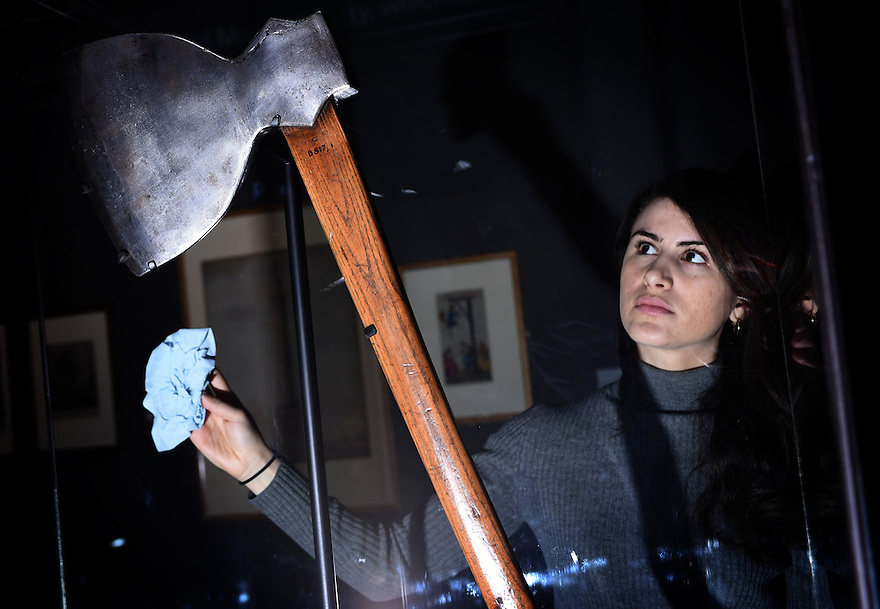 EVIE JEFFREYS, EXHIBITIONS TEAM, POLISHES A CASE CONTAINING AN AXE ON LOAN FROM THE MUSEUM OF LONDON. PART OF THE BRITISH LIBRARY'S MAGNA CARTA: LAW, LIBERTY,LECACY EXHIBITION OPENING ON MARCH 13TH.PHOTO BY CLARE KENDALL. FOR FURTHER INFO CONTACT PRESS OFFICE 02074127110