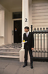Butler with drink tray waiting for guests private party London England. Circa 1985