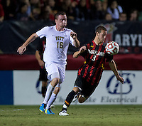 Michael Sauers (3) of Maryland controls the ball in front of Michael Tuohy (16) of Pittsburgh during the game at Ludwig Field on the campus of the University of Maryland in College Park, MD.  Maryland defeated Pittsburgh, 2-0.