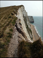 BNPS.co.uk (01202 558833).Pic: RachelAdams/BNPS..Recent cleft near Lulworth Cove in Dorset...Unprecedented weather takes its toll on Britains crumbling coast...The South West coast path is under threat after a series of landslips and cliff falls have left the Jurassic coast World Heritage site with some dinosaur sized clefts and chasm's...Walkers could soon face being deprived of some of the country's most beautiful views after the prolonged cold and wet winter has led to a series of devastating landslides...Since last April heavy rain has caused several landslides on large sections of the Jurassic Coast in Dorset, forcing authorities to close parts of the popular coastal path...Last July holidaymaker Charlotte Blackman, 22, was killed when a landslide caused 400 tons of rocks to fall on her from above as she walked along a beach at Burton Bradstock...And a recent landslide at popular tourist spot Durdle Door means sections of the nearby coastal path overlooking the famous sight have been closed due to safety concerns...On that occasion around 400 tons of chalk rock covered the beach below after collapsing from the 90-million-years-old cliff...Fresh cliff falls and cracks appeared along the coast on Sunday as coastguards issued a warning saying the pathway is falling away.