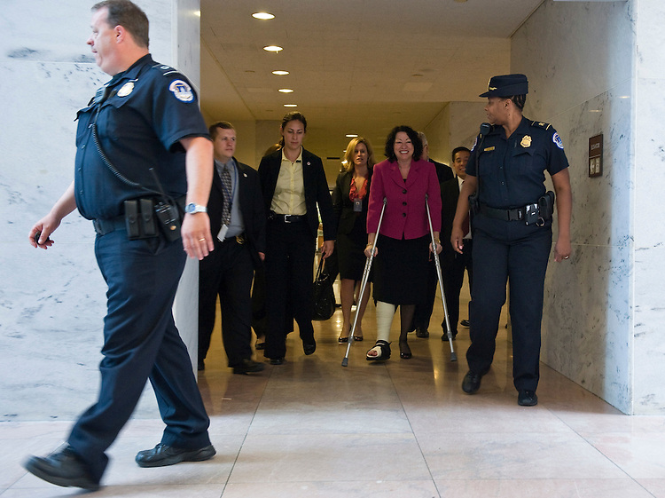 Supreme Court nominee Sonia Sotomayor hobbles on crutches through the Hart Senate Office building on her way to meet with Sen. Charles Grassley, R-Iowa, on Monday afternoon, June 8, 2009. Judge Sotomayor tripped and fractured her ankle at New York's LaGuardia Airport earlier in the day as she returned to Washingtington for more meetings with Senators on Capitol hill.