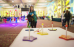 Eve Ullmann, 14, of Cincinnati, Ohio, throws a ring in a ring toss game at the Sibs Carnival during Siblings Weekend on February 6, 2016. Photo by Emily Matthews