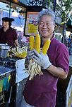 Bellmore, New York, USA. 20th September 2015. Vendor holds three ears of cooked corn on the cob, on sale for $1 each, near the end of the day during the 29th Annual Bellmore Family Street Festival. The popular Nassau County fair is made possible by volunteers from the Chamber of Commerce of the Bellmores, the event host.