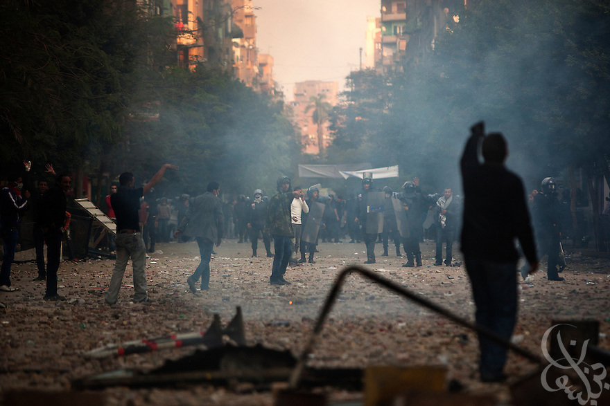 Egyptian protestors clash with large police lines during ongoing demonstrations November 20, 2011 near Tahrir square in central Cairo, Egypt.  Protestors demanding the transition of power from military to civilian control clashed with Egyptian security forces for a second straight day in central Cairo, with hundreds injured and at least 11 protestors killed.  (Photo by Scott Nelson)