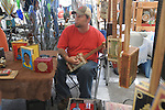 Gene Smith makes cigar box guitars at the Double Decker Arts Festival in Oxford, Miss. on Sunday, April 25, 2010.