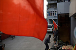 Chinese Olympic team fans hang flags outside their shop in Beijing, China on Tuesday, August 5, 2008. The city of Beijing is gearing up for the opening ceremonies of the Olympic Games.  Kevin German