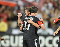 D.C. United midfielder Chris Pontius (13) celebrates his score with teammate Perry Kitchen (23) D.C. United defeated The New England Revolution 2-1 at RFK Stadium, Saturday September 15, 2012.