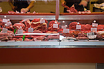 Butchers preparing meat for sale, at a food market in Santa Cruz, Tenerife.