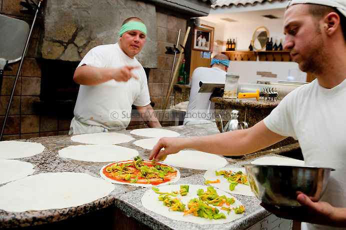 Friday night peak hour at 'Remo' pizzaria, popular pizzaria in the Testaccio district of Rome, Italy