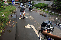 Road markings to direct traffic on an alternative route around the affected mud flow area, since the mud destroyed the main Surabaya-Malang toll road. Since May 2006, more than 10,000 people in the Porong subdistrict of Sidoarjo have been displaced by hot mud flowing from a natural gas well that was being drilled by the oil company Lapindo Brantas. The torrent of mud - up to 125,000 cubic metres per day - continued to flow three years later.