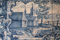 The iron pot and the clay pot, from the fables of La Fontaine, traditional blue and white azulejos tile scene, 18th century, in the cloister of the Monastery of Sao Vicente de Fora, an Augustinian order monastery and church built in the 17th century in Mannerist style, Lisbon, Portugal. The monastery also contains the royal pantheon of the Braganza monarchs of Portugal. Picture by Manuel Cohen