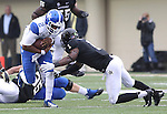 UK quarterback Jalen Whitlow runs the ball during the second half of the University of Kentucky vs. Vanderbilt University football game at Vanderbilt Stadium in Nashville, Tenn., on Saturday, November 16, 2013. Vanderbilt won 22-6. Photo by Tessa Lighty | Staff
