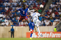 Haiti midfielder Jean-Marc Alexandre (16) goes up for a header with Honduras midfielder Rony Martinez (11). Honduras defeated Haiti 2-0 during a CONCACAF Gold Cup group B match at Red Bull Arena in Harrison, NJ, on July 8, 2013.