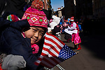 New York, United States. 17th February 2013 -- A Chinese girl watch residents taking part of the lunar new year of the snake during celebrations of the Chinese new year in New York. Photo by Eduardo Munoz Alvarez / VIEWpress.