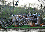 Damage to homes from an aparent tornado in Waterfront Cove on Lake Guntersville Friday afternoon.  Bob Gathany Photo.