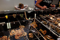 Reptile shows are full of exotic snakes for sale. The pet industry is largely responsible for the introduction of exotic pets into our enivornment. The US dominates both import and export in the booming reptile trade. More than 2.5 million reptiles are brought in annually. Enough are released &quot;into the wild&quot; when they become too large or require too much of an owners time, that feral colonies of green lizards, boa constrictors, cane toads <br /> and 32 exotic species have set up housekeeping in Florida. In turn, Florida ships out 9.5 million reptiles including 8.5 million red-eared slider turtles from the farms and swamps of Louisiana. They are exported for food sources in Asia, but are now illegal. There are few <br /> controls of what can be imported--you can buy about anything--22 of 24 species of pythons as available. Boas, crocodiles, iguanas, bird-eating spiders.