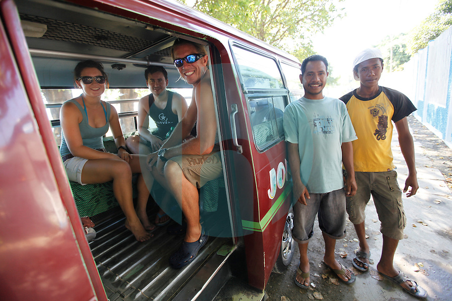 June 8th, 2010_DILI, TIMOR-LESTE_A group of divers enjoy the use of a local form of transportation called a Mikrolet during a dive trip in the capital city of Dili, in Timor-Leste, Asia's newest nation. Photographer:  Daniel J. Groshong