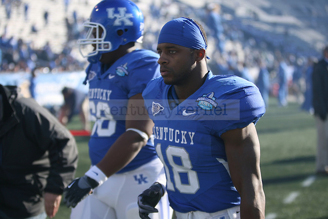 UK's Randall Cobb walks off the field in dissapointment after losing to Pittsburgh 27-10 at Legion Field on Saturday, Jan. 8, 2011. Photo by Scott Hannigan | Staff