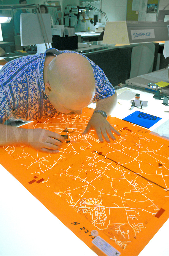 Cartographer working on map film