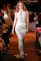 Model walks the runway in a Rapture wedding dress - silk crepe back satin/crochet lace satin halter gown, by Sarah Jassir, for the Sarah Jassir Couture Bridal Fall 2012 Opulence collection.