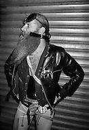 May, 1980. Manhattan, New York City, NY. A man with outrageous attire loiters on the side streets of Times Square, a constant freak show with a strange looking crowd.<br /> <br /> Manhattan, New York City, NY. Mai, 1980. Cet homme &agrave; l&rsquo;accoutrement bizarre est typique de la faune de la 42eme rue de cette &eacute;poque. Son originalit&eacute; ostentatoire n&rsquo;incite pas &agrave; l&rsquo;accoster ni &agrave; les rencontrer.