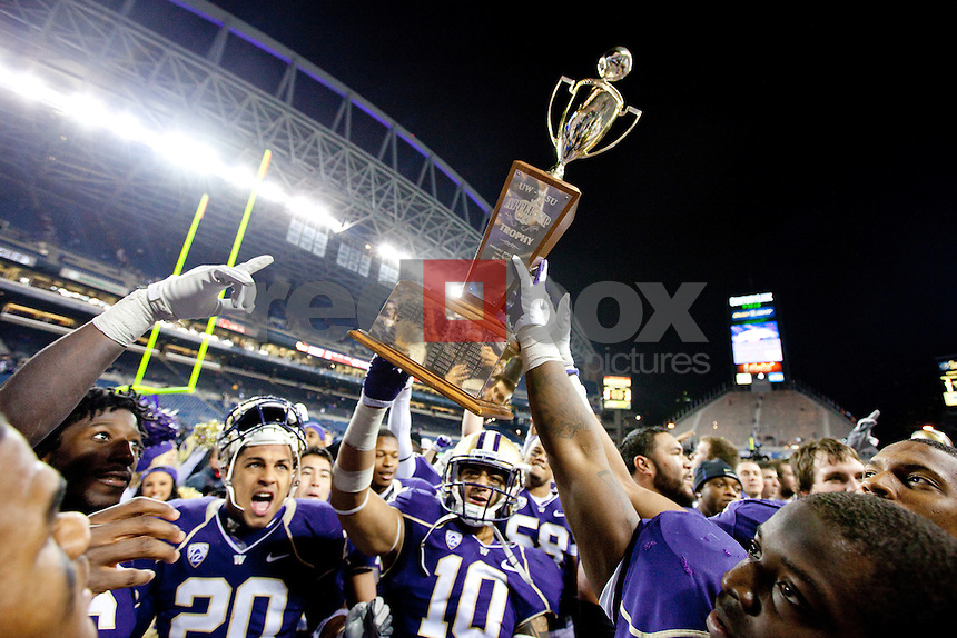 Apple Cup Trophy. The University of Washington beat Washington State University to win the 2011 Apple Cup 38-21 at Century Link Field in Seattle on Saturday November 26, 2011 (Photography By Scott Eklund/Red Box Pictures)