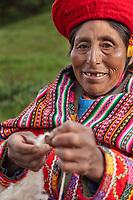 Quechua woman works wool into yarn, Lima Peru, South America