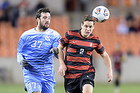 Houston, TX - Friday December 9, 2016: Walker Hume (37) of the North Carolina Tar Heels and Foster Langsdorf (2) of the Stanford Cardinal chase after a loose ball at the NCAA Men's Soccer Semifinals at BBVA Compass Stadium in Houston Texas.