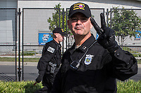 A North Carolina Highway Patrol officer flashes a peace sign near the security perimeter for the Democratic National Convention on Monday, September 3, 2012 in Charlotte, NC.