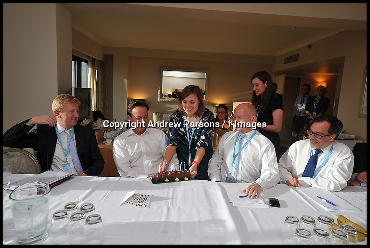 Prime Minister David Cameron, celebrates his birthday with members of staff including William Hague  during the Conservative Party Conference at ICC, Birmingham, on the second day of the Party Conference, Tuesday October 9, 2012. Birmingham, England. Photo by Andrew Parsons / i-Images..