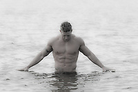 sexy man standing in the ocean in East Hampton, NY