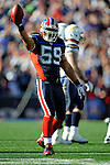 19 October 2008:  Buffalo Bills' linebacker Kawika Mitchell celebrates a turnover against the San Diego Chargers at Ralph Wilson Stadium in Orchard Park, NY. The Bills defeated the Chargers 23-14 and maintain their first place position in the AFC East with a 5 and 1 record...Mandatory Photo Credit: Ed Wolfstein Photo