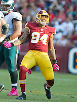 Washington Redskins outside linebacker Preston Smith (94) celebrates a late fourth quarter sack against Philadelphia Eagles quarterback Carson Wentz (11)  at FedEx Field in Landover, Maryland on Sunday, October 16, 2016. The Redskins won the game 27 - 20.<br /> Credit: Ron Sachs / CNP /MediaPunch