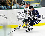 30 November 2009: University of Vermont Catamount defenseman Josh Burrows, a Junior from Prairie Grove, IL, checks Yale University Bulldog forward Andrew Miller, a Freshman from Bloomfield Hills, MI, during a game at Gutterson Fieldhouse in Burlington, Vermont. The Catamounts shut out the Bulldogs 1-0 in a rematch of last season's first round of the NCAA post-season playoff Tournament. Mandatory Credit: Ed Wolfstein Photo
