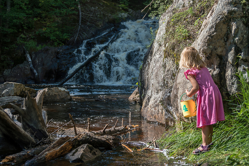 Exploring Pinnacle Falls on the Yellow Dog River in Marquette, Michigan.