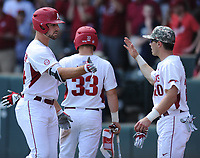 NWA Democrat-Gazette/ANDY SHUPE<br />Arkansas first baseman Chad Spanberger (24) is congratulated by second baseman Carson Shaddy against Georgia Saturday, April 15, 2017, after hitting a three-run home run during the second inning at Baum Stadium in Fayetteville. Visit nwadg.com/photos to see more photographs from the game.