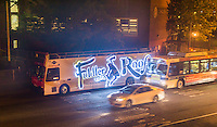 """Bright LED illuminated advertising for the Broadway show, """"Fiddler on the Roof"""" on the side of a tour bus parked in New York on Thursday, June 30, 2016. (© Richard B. Levine)"""