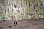 A girl plays with a hula hoop in the Ajuong Thok Refugee Camp in South Sudan. The camp, in northern Unity State, hosts thousands of refugees from the Nuba Mountains, located across the nearby border with Sudan.