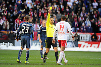 Thierry Henry (14) of the New York Red Bulls receives a yellow card for a foul on David Beckham (23) of the Los Angeles Galaxy during the 1st leg of the Major League Soccer (MLS) Western Conference Semifinals at Red Bull Arena in Harrison, NJ, on October 30, 2011.